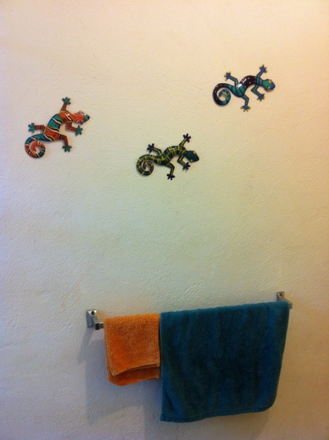 Recycled oil drum lizards on our bathroom wall.